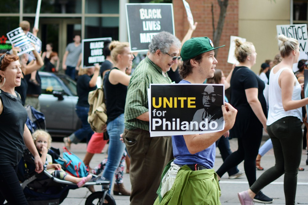 Protesters march down Wabasha Street North on Tuesday, Sept. 6, 2016 downtown St. Paul.
