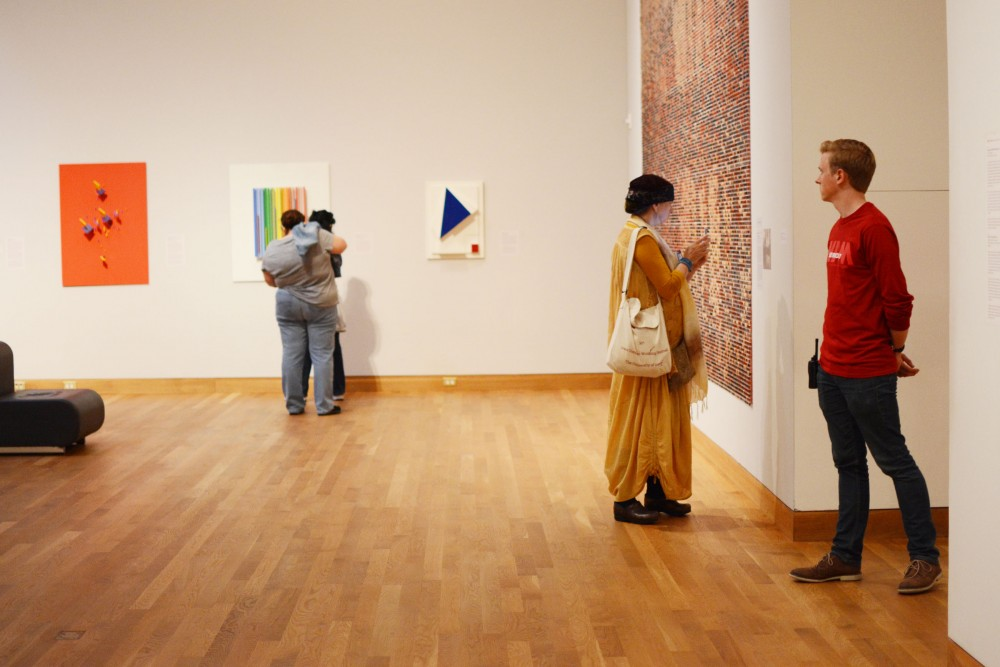 Junior Patrick Griffin guards the galleries on Tuesday, Sept. 6, 2016 at the Weisman Art Museum on East Bank.