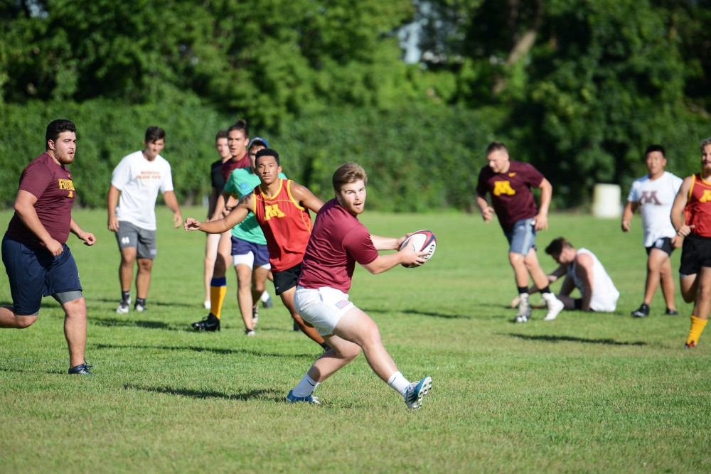 The University of Minnesota Club Rugby Team practices on Sept. 2, 2016.