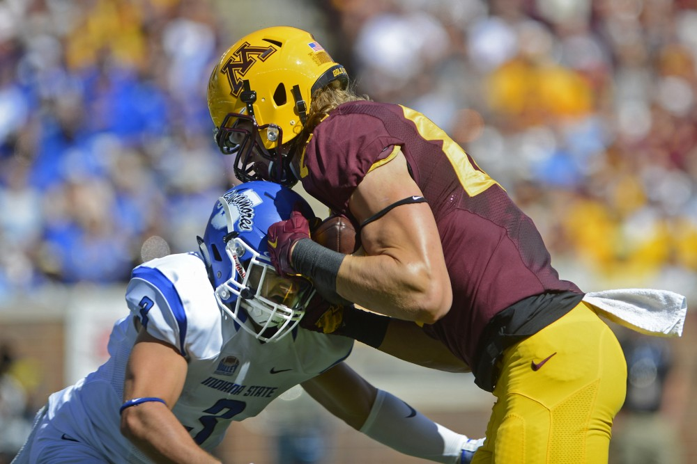 Gophers tight end Nate Wozniak pushes through Indiana State defensive back Tsali Lough at TCF Bank Stadium on Saturday, Sept. 10, 2016.