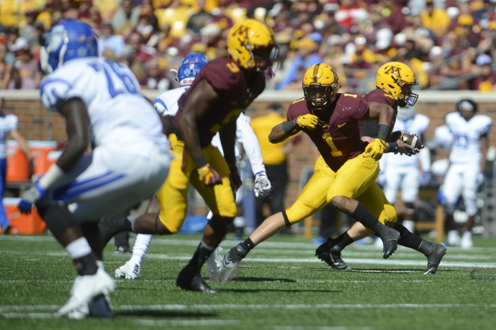Gophers running back Rodney Smith runs after a handoff on Saturday, Sept. 10, 2016 at TCF Bank Stadium while playing against Indiana State.