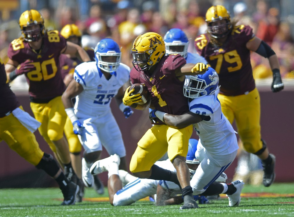 Sophmore running back Rodney Smith is tackled on Saturday, Sept. 10, 2016 at TCF Bank Stadium while playing against Indiana State.