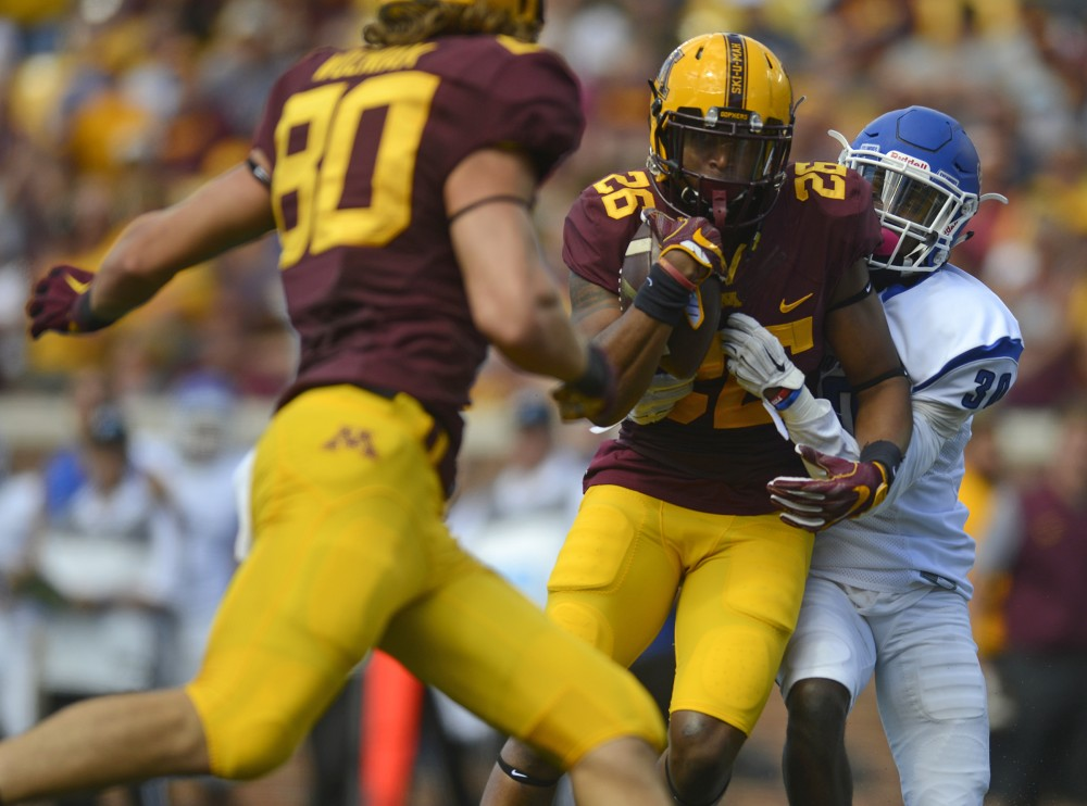 Junior wide receiver Brian Smith is tackled on Saturday, Sept. 10, 2016 at TCF Bank Stadium while playing against Indiana State.