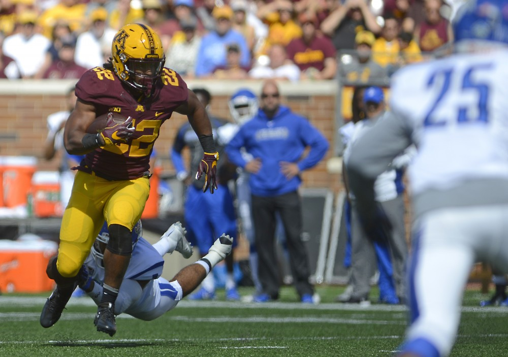 Junior running back Kobe McCrary runs the ball against Indiana State on Saturday, Sept. 10, 2016 at TCF Bank Stadium.