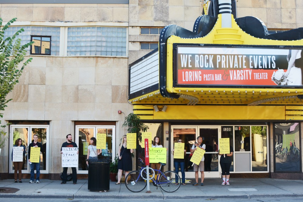 People protest in front of the Varsity Theater on Fourth Street on Saturday, Sept. 10, 2016 in Dinkytown.