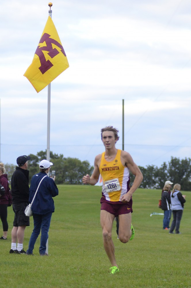 Redshirt junior Charlie Lawrence approaches the finish line of the Oz Memorial at Les Bolstad Golf Course on Sept. 11, 2015.