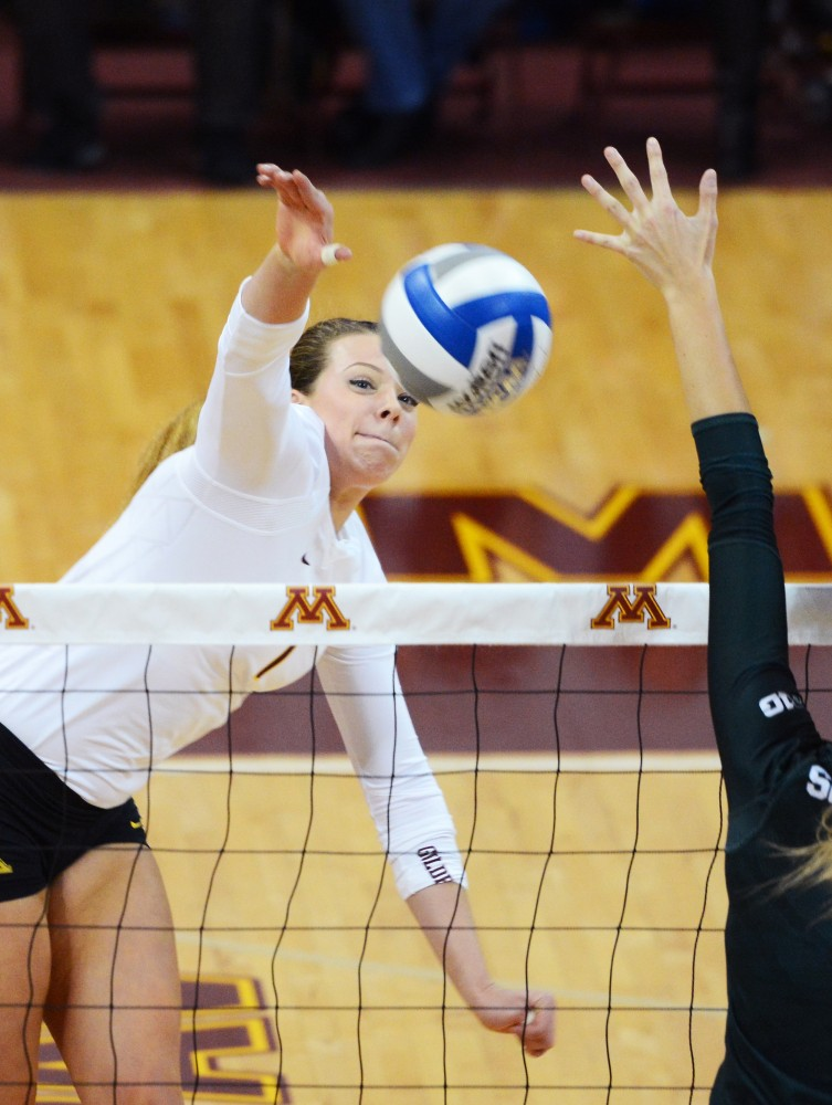 Middle blocker Hannah Tapp spikes the ball for a point on Friday, Nov. 6, 2015 at the Sports Pavilion.
