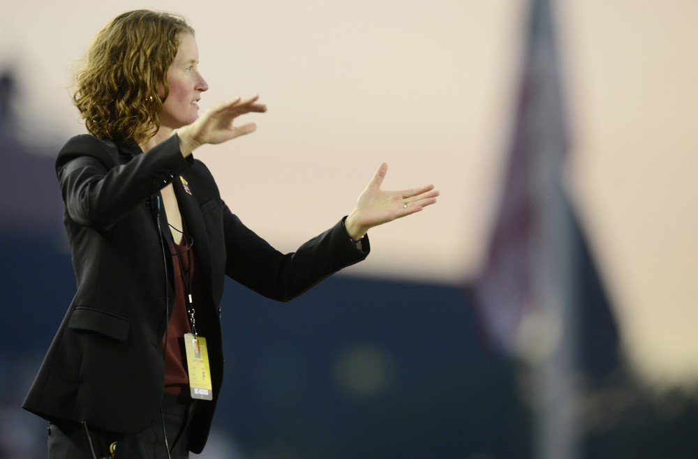 University Director of Marching and Athletic Bands Betsy McCann directs a football pre-game performance at TCF Bank Stadium on Sept. 1, 2016. McCann is the first female director of a marching band the University has had, as well as in the Big 10.