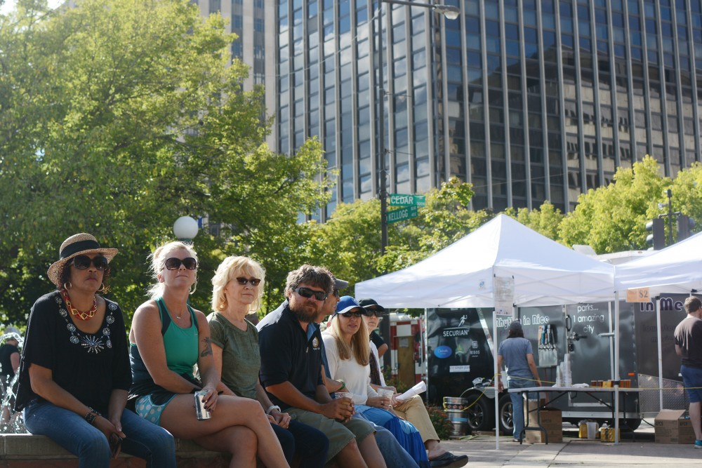 River Balcony Prototyping Festival attendees listen to live music on Saturday, Sept. 10, 2016 at Kellogg Mall Park in St. Paul.