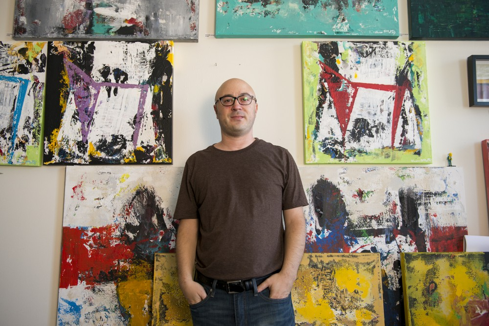 Artist Shawn McNulty poses for portraits in his Minneapolis studio on Sept. 9, 2016.