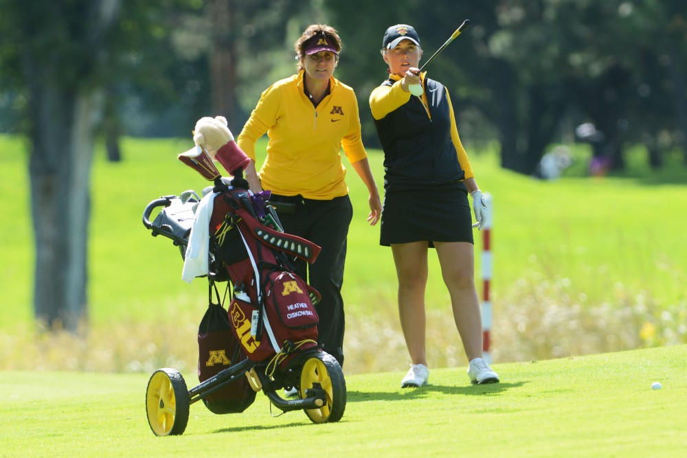 Junior Heather Ciskowski, right, talks to head coach Michele Redman before her swing at the fourth annual Minnesota Invitational on Tuesday, Sept. 13, 2016 at the Minikahda Club. Ciskowski tied for third place and the Gophers placed ninth in the season-opener tournament overall.
