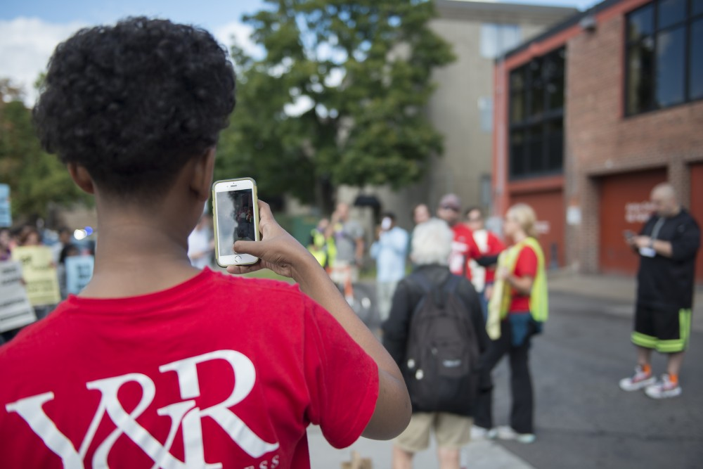 A protestor records a speech denouncing islamophobia given outside of the headquarters of the Republican Party of Minnesota on Saturday, Sept. 17, 2016.