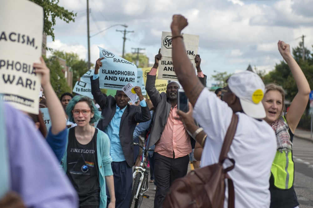 Protestors raise their firsts while chanting against islamophobia on Minnehaha Avenue on Saturday, Sept. 17, 2016.