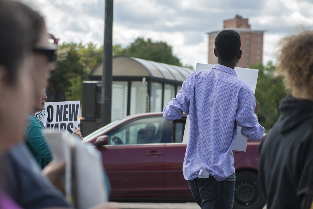 A passing driver watches as protestors march down Minnehaha Avenue in an effort to raise awareness of islamophobia on Saturday, Sept. 17, 2016.