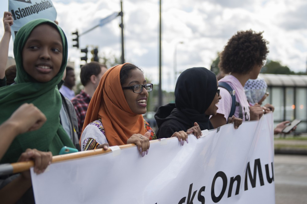Protestors chant denouncing islamophobia during a march on Minnehaha Avenue on Saturday, Sept. 17, 2016.