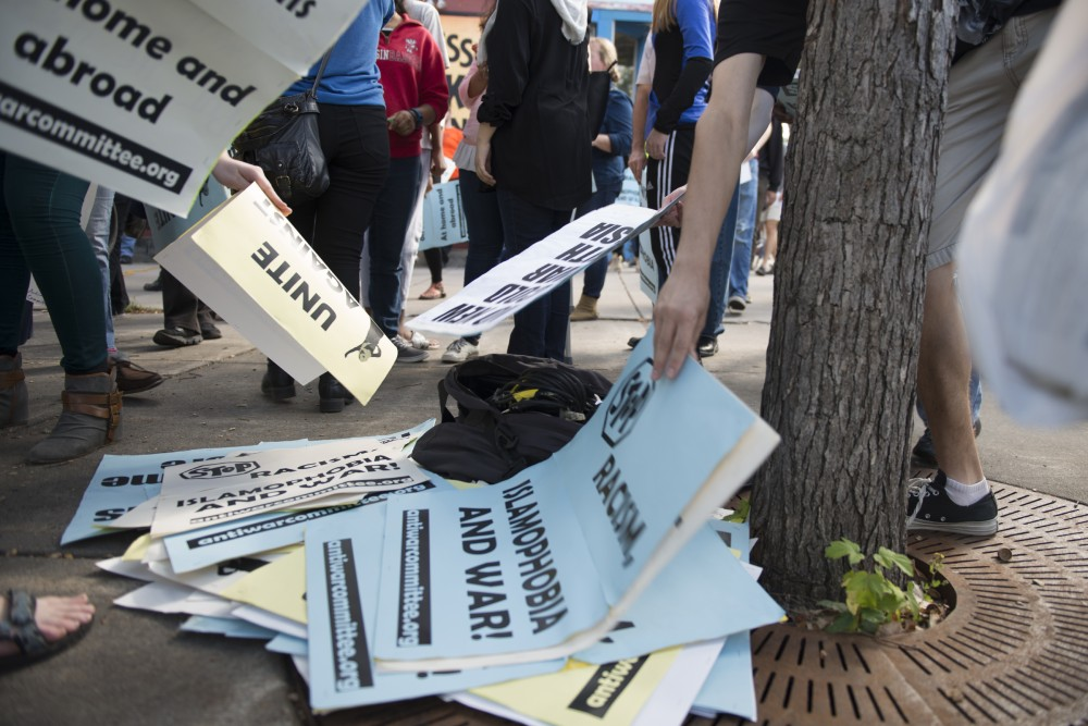 Protestors return signs denouncing islamophobia, racism and war following the march against islamophobia in the Cedar-Riverside neighborhood on Saturday, Sept. 17, 2016.