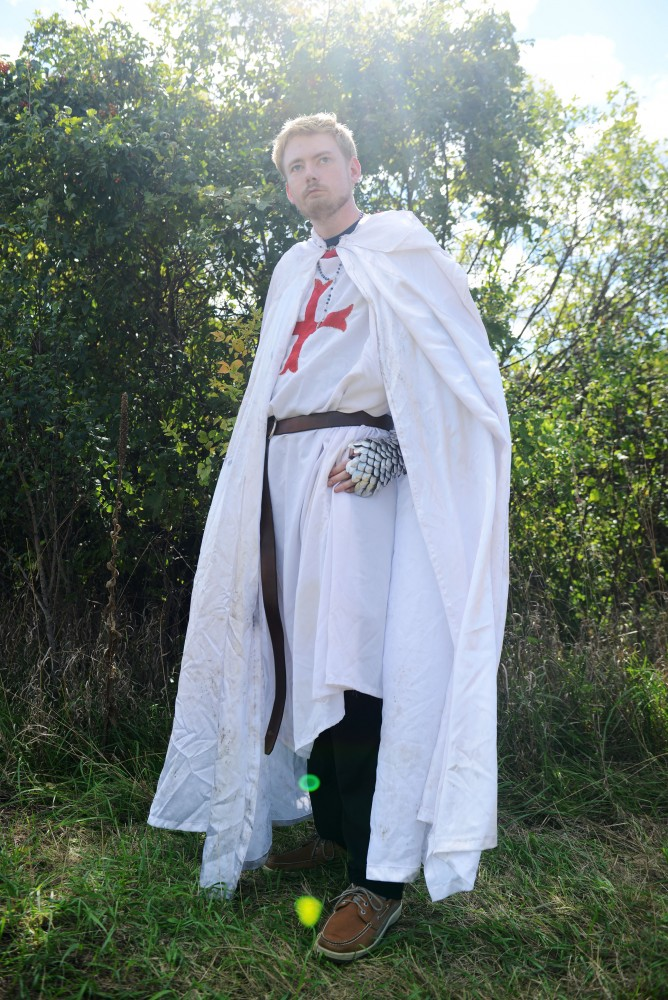 Thomas ONeil poses outside of the Minnesota Renaissance Festival in a knight costume featuring chain-mail armor on Sept. 17, 2016.