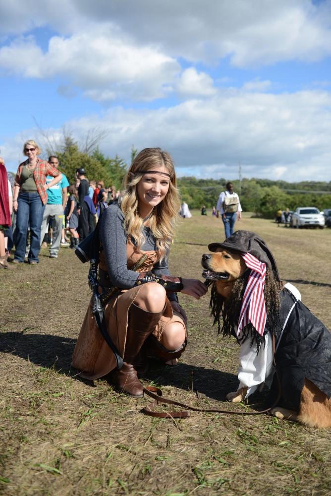 Jody McGuire poses outside of the Minnesota Renaissance Festival with her dog Chewy on Sept. 17, 2016. McGuire donned an elf costume while Chewy was dressed as a pirate for the fairs pet costume contest.