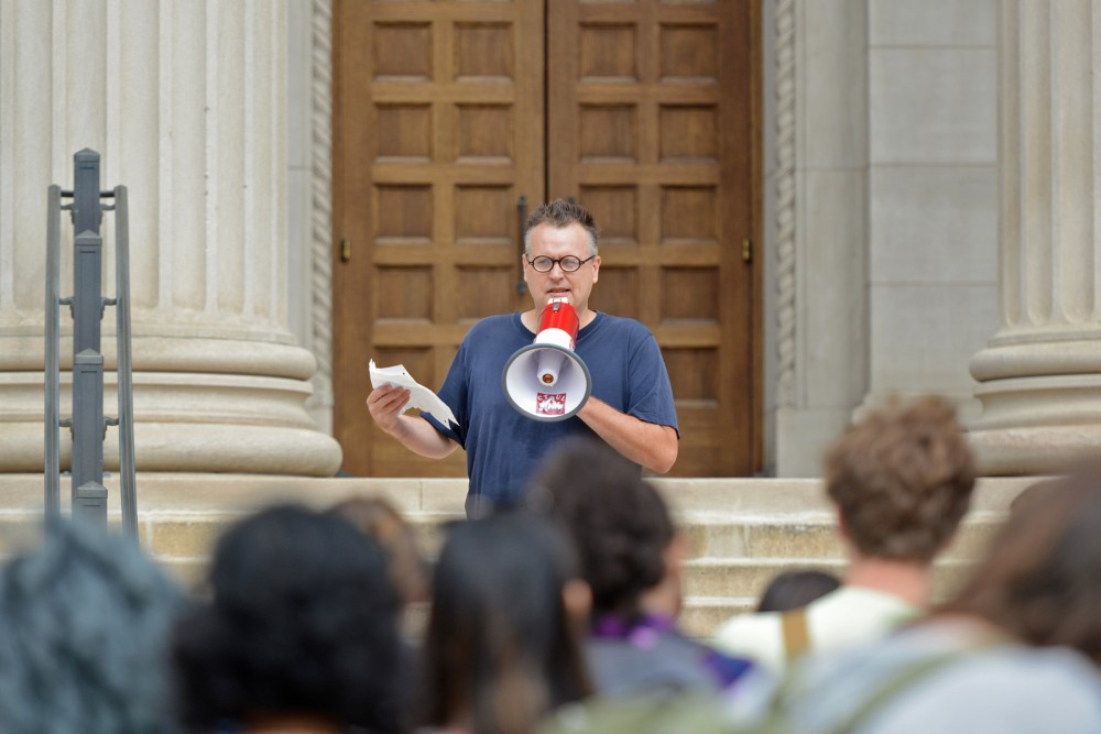 Lecturer William Banks speaks to protesters on Friday, Sept. 23, 2016 at Northrop Plaza. Student coalition Differences Organized gathered to protest the treatment of contingent faculty.