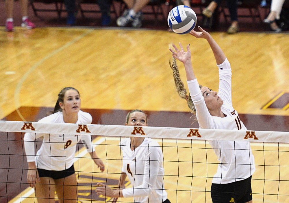 Gophers sophomore Samantha Seliger-Swenson sets the ball on Friday, Sept. 23, 2016 in a match against Maryland in the Sports Pavillon.