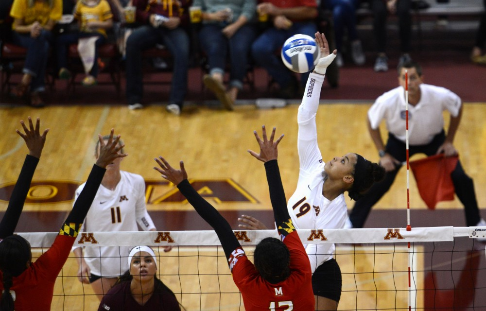 Freshman outside hitter Alexis Hart strikes the ball on Friday, Sept. 23, 2016 in theSports Pavillon.