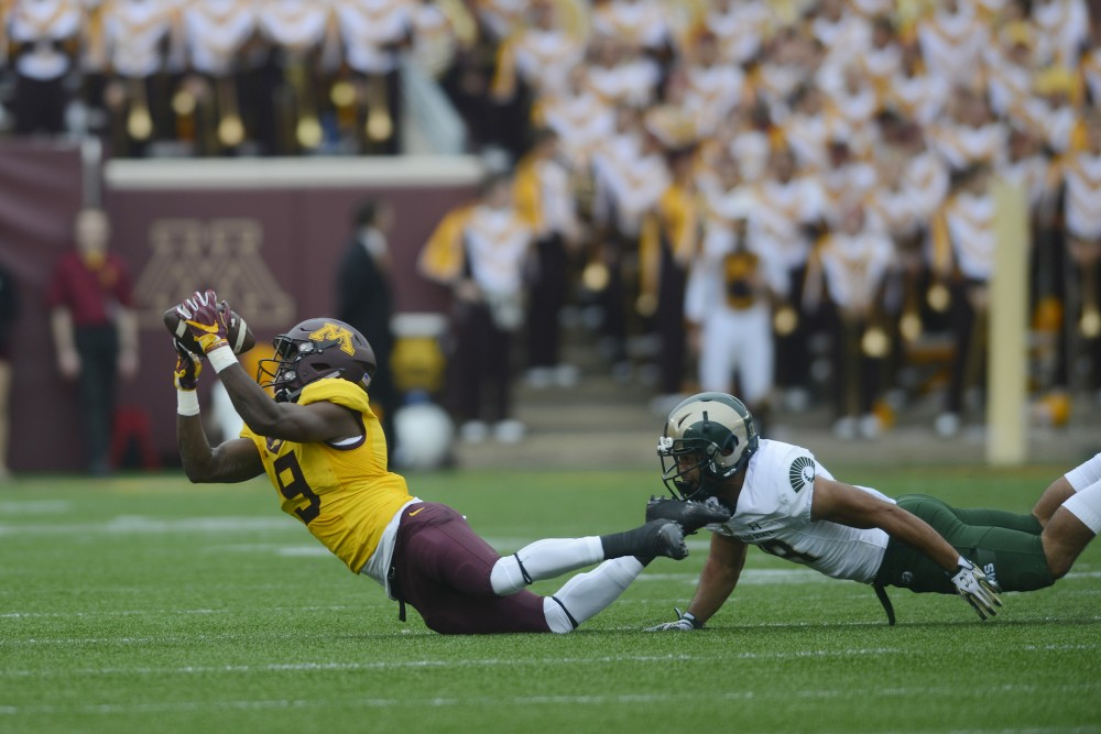 Colorado State attempts to take down redshirt junior wide receiver Eric Carter on Saturday, Sept. 24, 2016 at TCF Bank Stadium, where the Gophers beat the Rams 31-24.