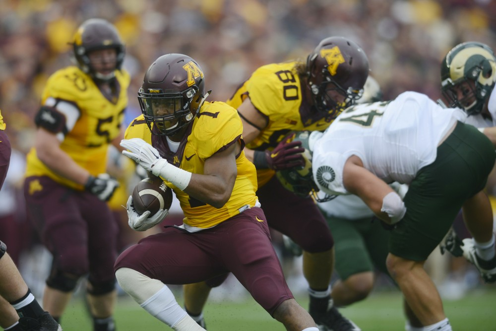 Redshirt sophomore running back Rodney Smith carries the ball on Saturday, Sept. 24, 2016 at TCF Bank Stadium, where the Gophers beat the Rams 31-24.