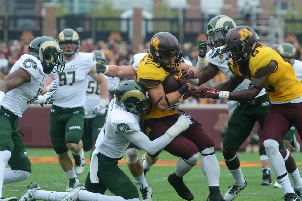Gopher running back Shannon Brooks holds firmly to the ball while getting taken down by Colorado State on Saturday, Sept. 24, 2016 at TCF Bank Stadium.