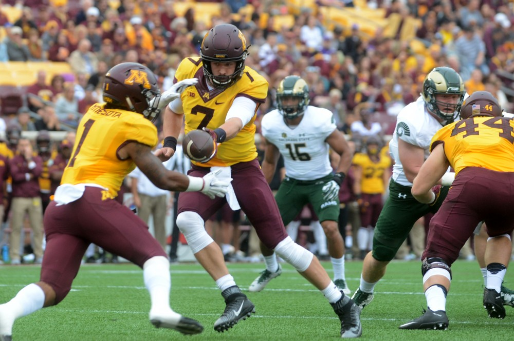 Gophers quarterback Mitch Lender hands the ball off to running back Rodney Smith on Saturday, Sept. 24, 2016 at TCF Bank Stadium.