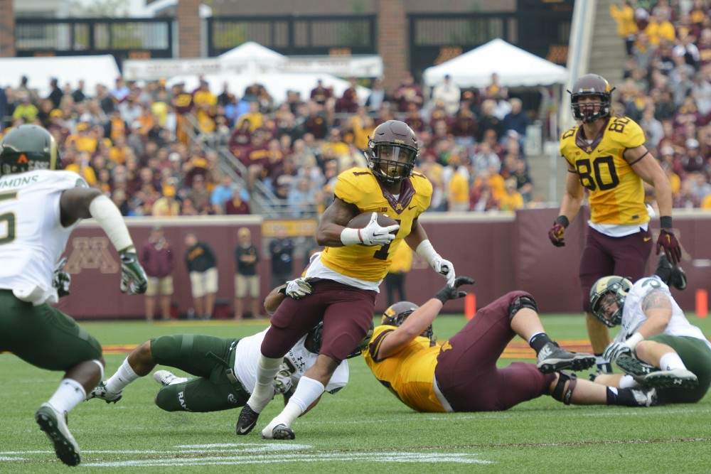 Running back Rodney Smith is tackled while playing against Colorado State on Saturday, Sept. 24, 2016 at TCF Bank Stadium.