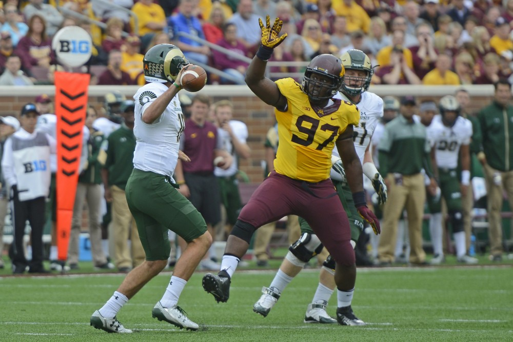 Defensive end Scott Ekpe attempts to block a pass by Colorado State at TCF Bank Stadium on Sept. 24, 2016.