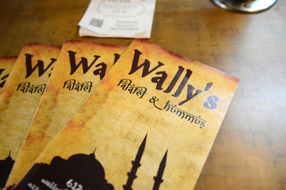Wallys Falafel and Hummus menus sit on a counter at the restaurant in Dinkytown on Sept. 26, 2016. The restaurant is an affordable staple in the area.