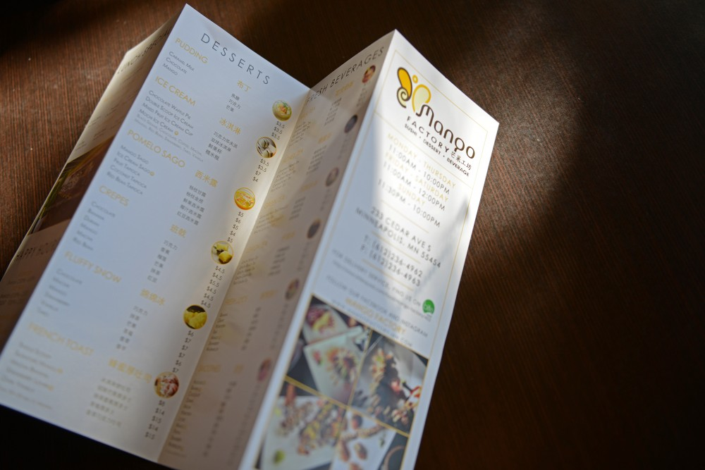 A menu from Mango Factory sits on a table at the restaurant on Sept. 26, 2016. The restaurant, located on West Bank, serves affordable sushi, desserts and beverages.