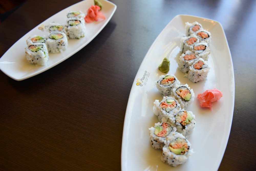 Two orders of sushi sit on a table at Mango Factory on Sept. 26, 2016. The restaurant, located on West Bank, serves affordable sushi, desserts and beverages.