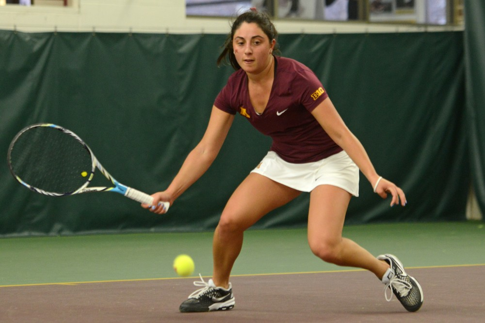 Sophomore AnneMarie Emme returns the ball to Penn State on March 18, 2016 at the Baseline Tennis Center.