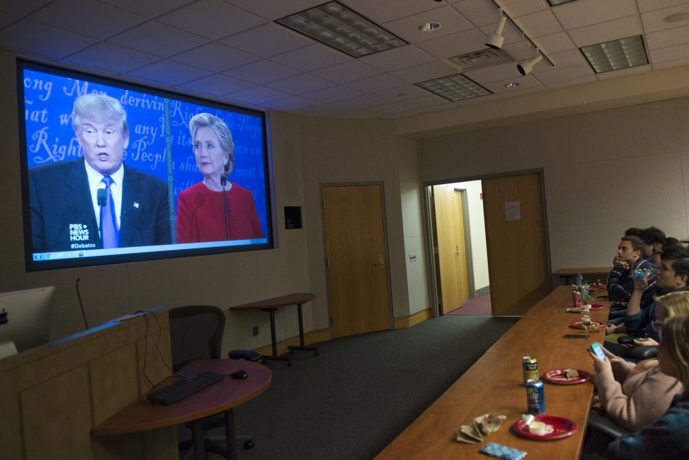 A group of journalism students watch the first presidential debate in Murphy Hall on Sept. 26, 2016. The students gathered to watch and discuss the debates while enjoying pizza and beverages.
