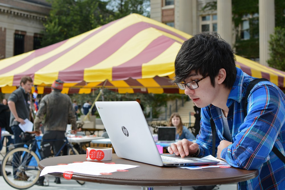 Psychology senior Joseph Moore registers to vote with the online software TurboVote at Voterpalooza hosted by MSA on Tuesday, Sept 27, 2016 at Northrop Plaza. MSA decided to use TurboVote this year to increase student registration on campus for the upcoming election.