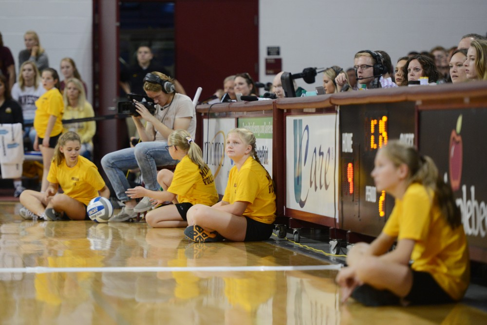 Minnesota Volley Squad girls sit on the side of the court on Friday, Sept. 23 in the Sports Pavillon.