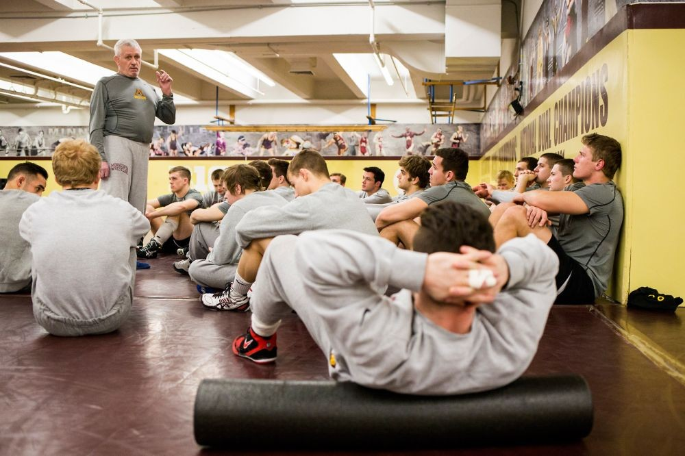 Former Gophers wrestling head coach J Robinson addresses his team on Jan. 20.