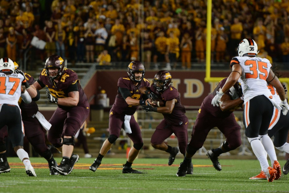 Gophers quarterback Mitch Leidner passes the ball to running back Rodney Smith on Thursday, Sept. 1, 2016 at TCF Bank Stadium.