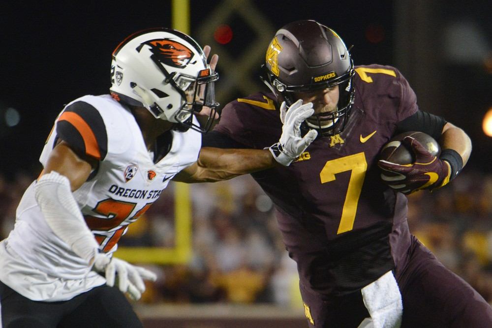 Gophers quarterback Mitch Leidner runs the ball while an Oregon State player attempts to tackle on Thursday, Sept. 1, 2016 at TCF Bank Stadium.