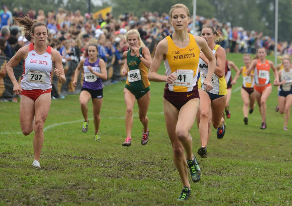 Freshman Elyse Prescott runs in the Jack Johnson Women's Gold Race at the Roy Griak Invitational on Saturday, Sept. 24, 2016 at Les Bolstad golf course.
