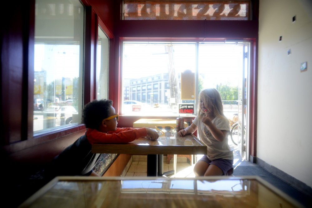 3-year-old Miles and 4-year-old Hazel wait for their doughnuts at Sssdude-Nutz on Saturday, Oct. 1, 2016 in Dinkytown. Sssdude-Nutz has just celebrated its one year anniversary and Tim Horton's has signed a lease to move in next door.