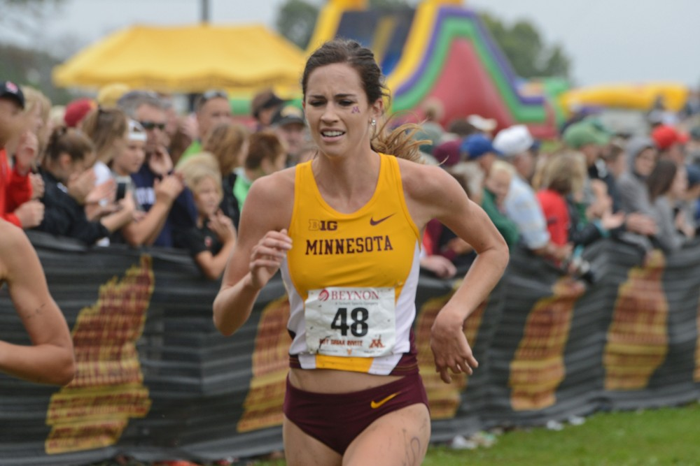 Redshirt junior Madeline Strandemo runs in the Jack Johnson Women's Gold Race at the Roy Griak Invitational on Saturday, Sept. 24, 2016 at the Les Bolstad golf course.