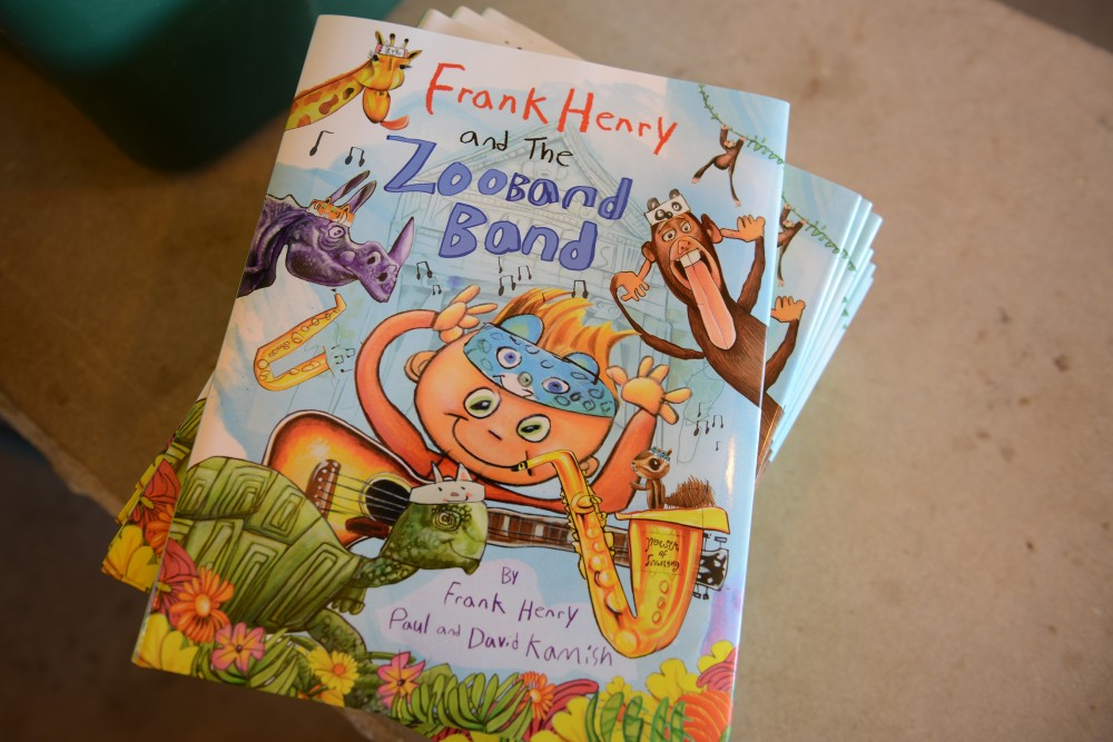 Copies of Frank Henry and the Zooband Band are displayed at Elmcrest Park in Ramsey on Saturday. Frank Kamish, the illustrator of the book, is a fifth grader at Lake Harriet Elementary who creates books with his father, Paul, and his uncle, David.