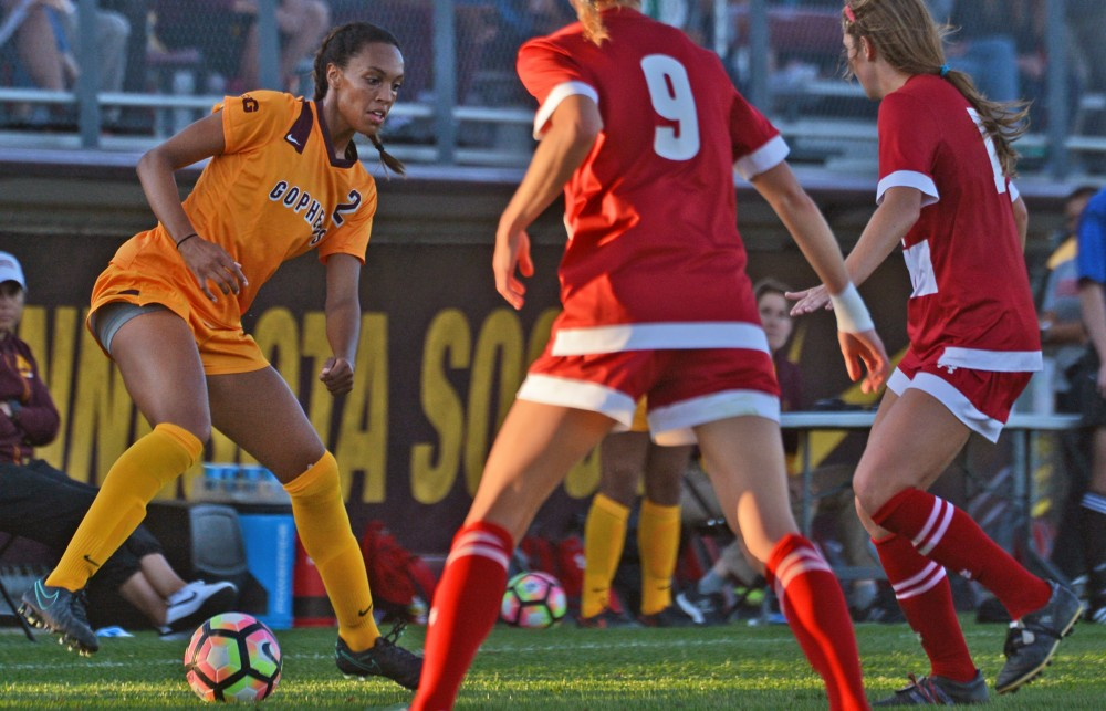Senior forward Simone Kolander tries to keep the ball from Wisconsin on Saturday, Oct. 1, 2016 at Elizabeth Lyle Robbie Stadium in St. Paul. Minnesota lost to Wisconsin in overtime 1-0 after both teams went scoreless through the game.