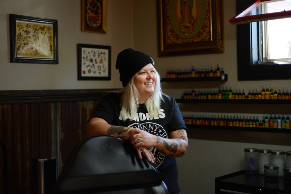 Shop owner and tattoo artist Nikki Time poses for a portrait  at MPLS Tattoo Shop on Friday, Sept. 30, 2016 in Minneapolis. Nikki specializes in watercolor styled tattoos.