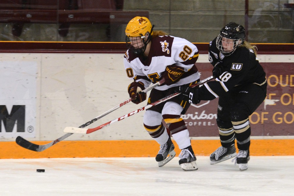 Freshman forward Alex Woken battles for the puck at Ridder Arena on September 30, 2016.