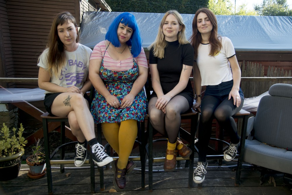 Shannon Bee, Stephanie Murck, Chloe Carson and Liz Coombs of the band Tights pose for a portrait on Monday, Oct. 3, 2016 in Minneapolis.