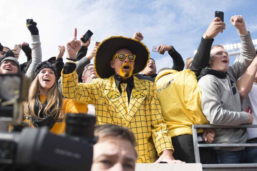 Hawkeyes fans celebrate their team's victory over the Gophers at TCF Bank Stadium on Oct. 8, 2016.